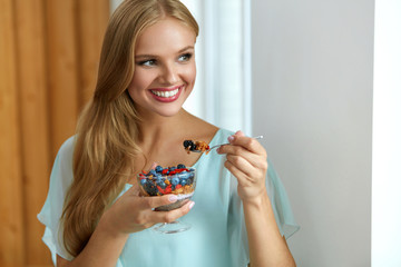 Healthy Diet. Woman Eating Cereal, Berries In Morning. Nutrition