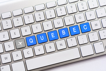 QUEBEC writing on white keyboard with a aircraft sketch