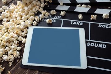 digital tablet with popcorn.