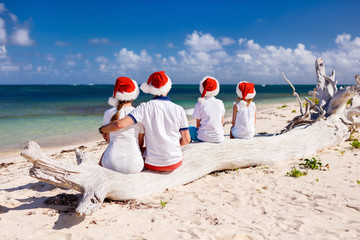 Family celebrating Christmas at beach
