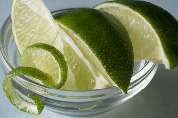Lime Wedges and twist in glass bowl