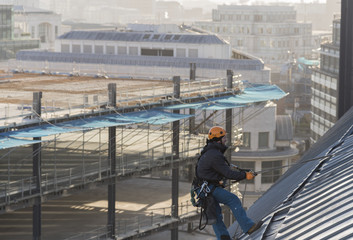 Industrial abseiler on the rooftop