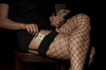 hooker in fishnet stockings counts money