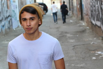 Hispanic urban young boy in alley way