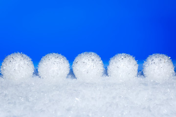Christmas snowballs on snow in the blue background