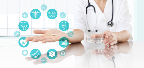 Doctor showing pill medicine with icons. Health care and medical concept