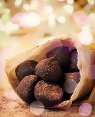 Christmas holiday treats, chocolate truffles art decoration with bokeh lights, beautiful festive toned image, selective focus