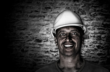 Portrait of a dirty and happy coal miner