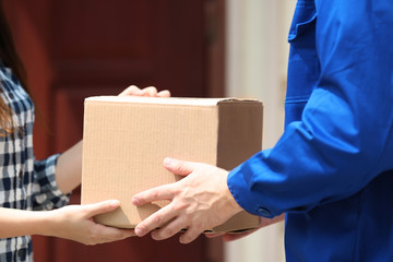 Male deliverer giving box to client