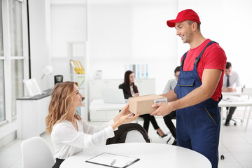 Courier delivering package in office