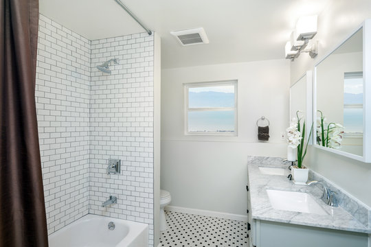 Beautiful Bathroom in white with shower curtain.