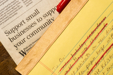Small Business Article and To Do List  with several completed items crossed off with red ink. The red marker cap rests on the newspaper.