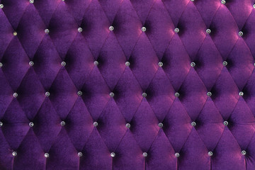 deep Purple velvet texture of sofa closeup shot - luxury violet velvet texture with diamond jewelry background.