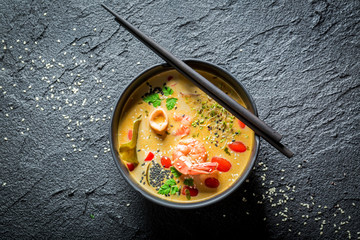Tasty Tom Yum soup with shrimps and coconut milk