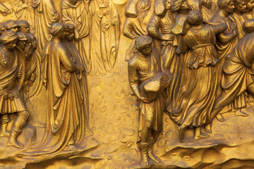 detail of the golden portal of the Baptistery of the Florence Cathedral in Florence, Italy
