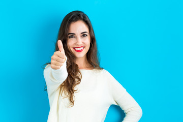 Happy young woman giving a thumb up