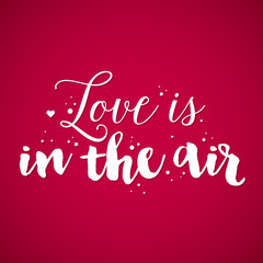 "Valentine's Day background with text ""Love is in the air"". Useful for cards, invitations and valentines."