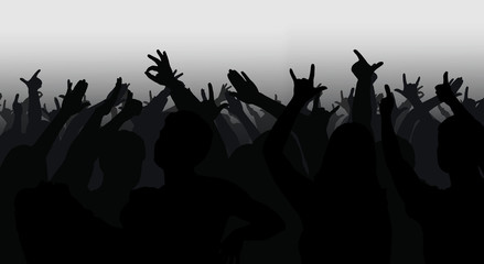 Silhouettes of crowd with hands raised