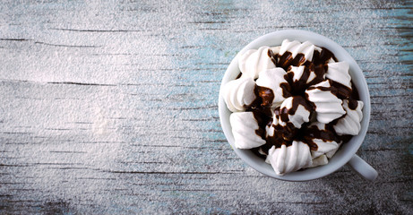 Poster Chocolate Cup of hot chocolate with marshmallows on snowy table, Christmas, New Year, Winter background