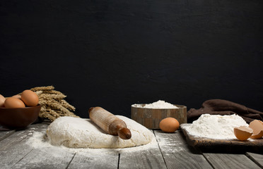 Wall Mural - Dough with wooden rolling pin, flour and eggs