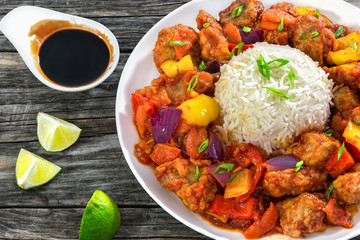 Sweet and Sour fried pork chunks with vegetables and rice