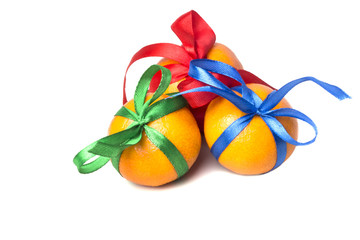 Three gift ripe tangerine with different thin ribbons