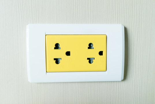 Yellow electricity plug