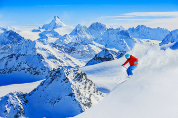 Skiing with amazing view of swiss famous mountains in beautiful.