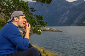 Young man is having fun hiking in Norway