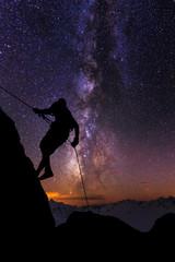 Climber on a background of the starry sky