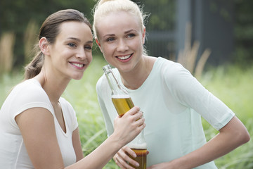 Women drinking beer together