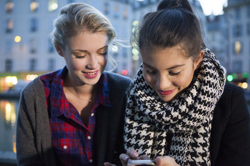Friends looking at smartphone together