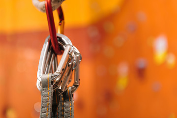 Close up of insurance climbing equipment hanging in gym