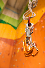 Close up of insurance climbing equipment in a gym