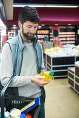 Man holding oil bottle shopping basket