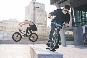 Two young guys jumping bmx