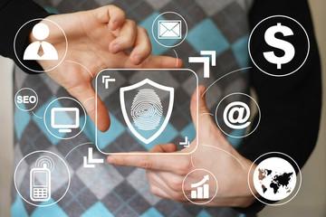 Businessman pressing button shield security virus fingerprint print virtual icon