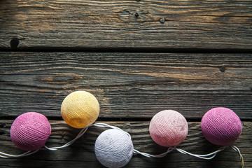 Cotton Christmas garland. Bright multi-colored decoration.
