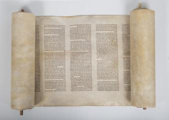 an ancient handwritten torah scroll