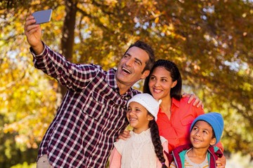 Happy family taking selfie at park