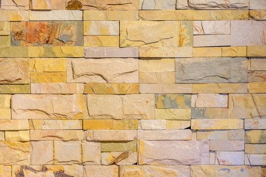 Brick wall in yellow pastel tone