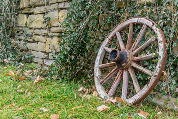 Wooden wheel on a stone wall