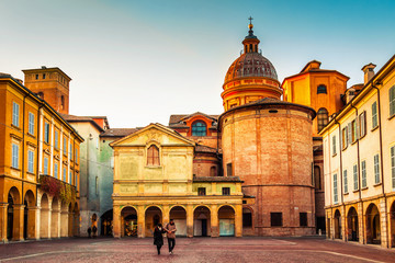Beautiful architecture at Piazza San Prospero in Reggio Emilia at sunset, Emilia-Romagna region, Italy.