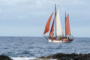 Boat sailing on the coast of Saint Paul on La Reunion