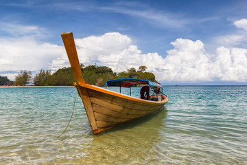 Fisherman boat float in blue sea with white sand beach and beaut