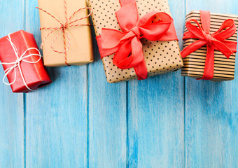 Christmas or New Year decorated gift boxes on blue wooden background
