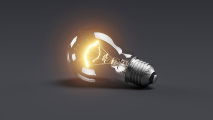 Low glowing electric bulb lamp on dark background