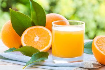 Fresh orange juice with oranges