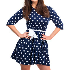 Woman in a dress with polka dot print
