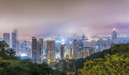 Hong Kong from above. Night panorama of foggy city from Victoria's peak